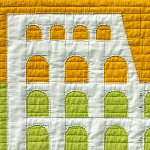 quilted detail of Colosseum (Rome, Italy) quilt block made with Art Gallery Fabrics Pure Solids. Foundation paper piecing pattern, part of Around the World Block of the Month Quilt Sew Along