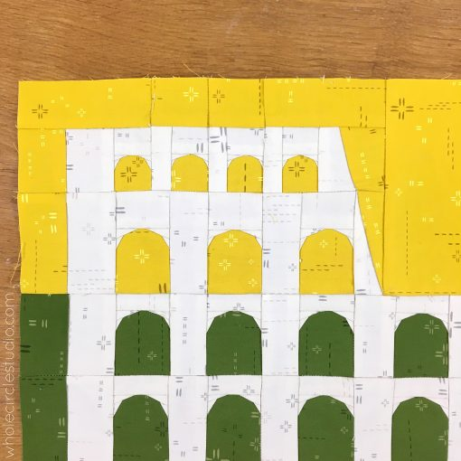 detail of Colosseum (Rome, Italy) quilt block made with Art Gallery Fabrics Elements. Foundation paper piecing pattern, part of Around the World Block of the Month Quilt Sew Along