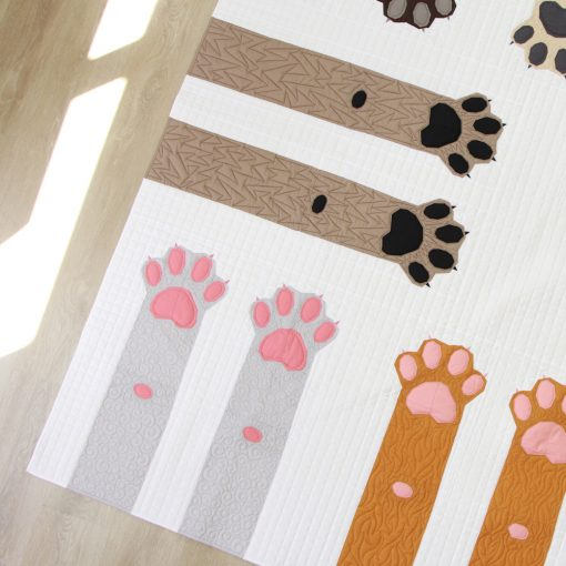 detail of Paws Up! an intermediate foundation paper pieced quilt pattern celebrating dogs and cats. Pattern makes 4 sizes—Mini, Throw, Twin and Queen. Pattern available at www.wholecirclestudio.com