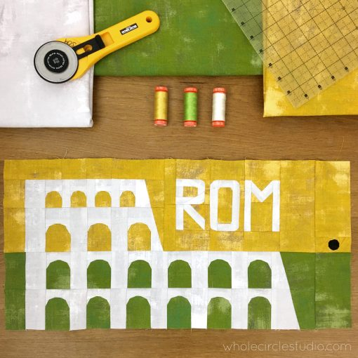 Around the World travel themed block of the month program. Make these blocks / mini quilts that celebrate architecture from around the world. Block 6 features the Colosseum in Rome, Italy. Made with Moda Grunge. Foundation paper pieced (FPP) quilt sew along. Available at wholecirclestudio.com