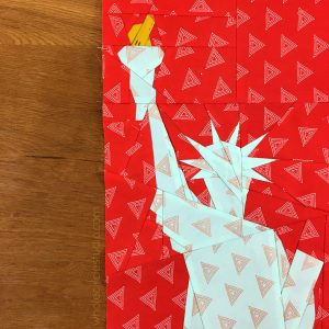 detail of Statue of Liberty (New York City, USA) quilt block made with Art Gallery Fabrics Elements. Foundation paper piecing pattern, part of Around the World Block of the Month Quilt Sew Along