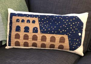 Easy envelope pillow made with Around the World quilt block — Colosseum, a foundation paper pieced pattern by Whole Circle Studio