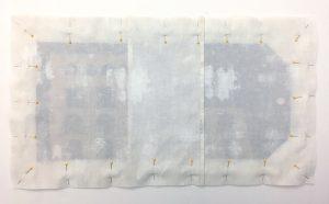 Pinning fabric to make an envelope pillow.