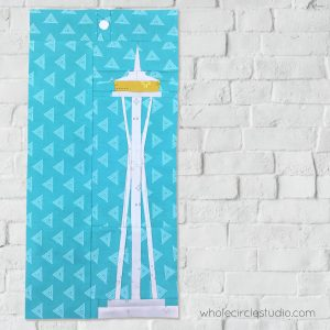 Space Needle (Seattle, Washington) quilt block made with Art Gallery Fabrics Elements. Foundation paper piecing pattern, part of Around the World Block of the Month Quilt Sew Along