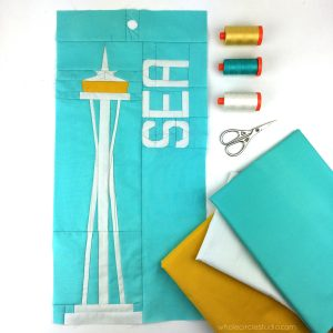 Space Needle (Seattle, Washington) quilt block made with Art Gallery Fabrics Pure Solids. Foundation paper piecing pattern, part of Around the World Block of the Month Quilt Sew Along