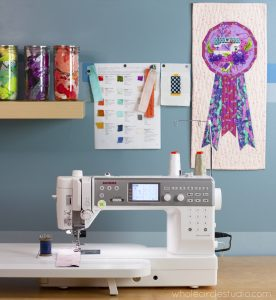 Inside the quilting space: Whole Circle Studio and their Janome 6700p. Quilt shown: Best in Show mini — pattern available at Whole Circle Studio